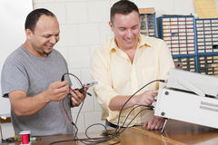 Engineering instructor and student using oscilloscope Stock Photo