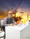 Engineering man with safety helmet working table against buildin Stock Photo
