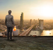 Engineering man standing on top of building looking to urban sce Royalty Free Stock Photo