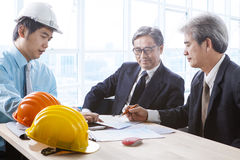 Engineering man team work serious project meeting in office meet Royalty Free Stock Photo
