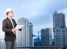 Engineering man wearing western suit and safety helmet with buil Royalty Free Stock Photo