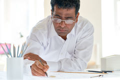 Engineering occupation. Modern engineer with pencil drafting in office Royalty Free Stock Photos