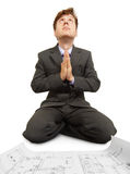 Engineering prays to Technology God on knees Stock Photo