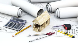 Engineering project architect with tools and wooden house Stock Photography