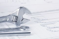 Engineering project drawing documents with wrench royalty free stock photography