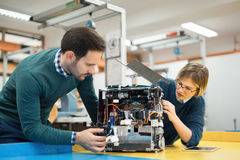 Engineering robotics class teamwork. By students stock photo