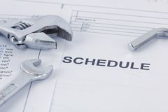 Engineering schedule documents with wrench. Maintencance concept stock image