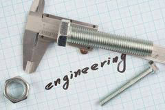 `engineering` - Screw and Nuts on graph paper. Background Royalty Free Stock Images