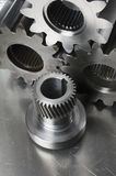Engineering-still-life. Three gear-wheels and an axel gear Stock Images