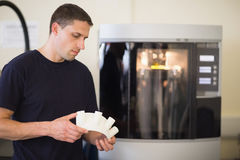 Engineering student holding object printed from 3d printer Stock Photos
