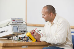 Engineering student measuring circuit board signals Stock Images