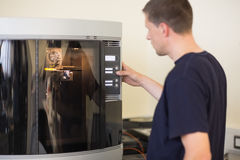 Engineering student using 3d printer Royalty Free Stock Photos