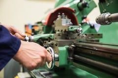 Engineering student using heavy machinery Stock Photo