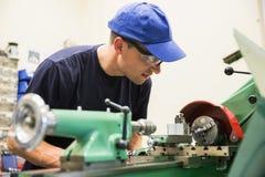 Engineering student using heavy machinery Royalty Free Stock Photo
