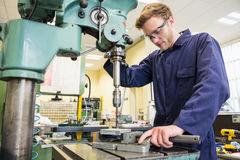 Engineering student using large drill stock photography