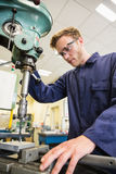 Engineering student using large drill Stock Photos