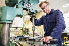 Engineering student using large drill Royalty Free Stock Photo