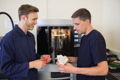 Engineering students using 3d printer Royalty Free Stock Image
