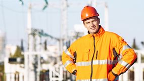 Service engineer standing near heat electropower station Royalty Free Stock Image