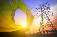 Engineering of Technology Expertise. Engineering of Electrical Expertise Concept. Blending with pylons during sunset Stock Photography