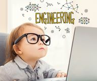 Engineering text with toddler girl. Using her laptop Stock Photo