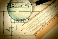 Engineering tools on technical drawing. Old engineering tools on a technical drawing stock photo