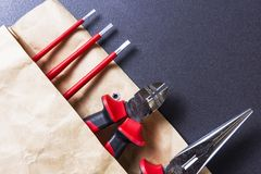 Engineering tools. Tools for electrician work. Screwdriver, pliers and platypus pliers. Stock Photo