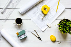 Engineering tools on wooden table with drawings apartments top view Stock Image