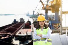 Engineering wearing yellow helmet and working at construction stock photo