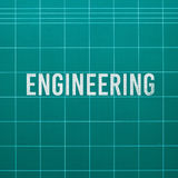Engineering word on cutting mat Royalty Free Stock Images
