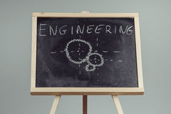 Engineering word written on chalkboard Royalty Free Stock Images
