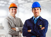 Engineers. At work in a construction site Royalty Free Stock Photography