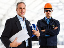 Engineers. Smiling engineers in a construction site Stock Photography