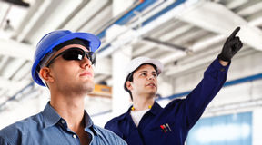Engineers. At work in a factory Royalty Free Stock Images