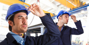 Engineers. Two engineers at work in a factory Royalty Free Stock Image