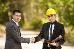 Engineers. One with yellow helmet in park Royalty Free Stock Image