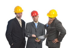 Engineers. Team of engineers looking at a file isolated in white Royalty Free Stock Photo