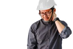 Engineers are aching neck and shoulder from hard work. On a white background royalty free stock image