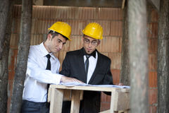 Engineers in action. Engineers with yellow helmet in a contruction house Stock Photo