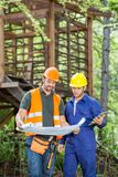 Engineers Analyzing Blueprint At Construction Site Royalty Free Stock Photo