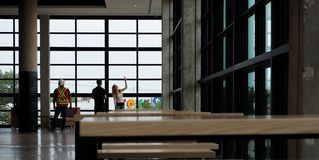 Engineers And Workman In Modern Food Court With Windows Royalty Free Stock Images