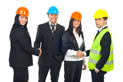 Engineers and architects teams handshakes stock photo