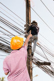 Engineers boy. A boy wearing engineers cap and stand at construction site of create a phone line Stock Photo