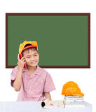 Engineers boy. A boy wearing engineers cap and talk by phone Royalty Free Stock Image