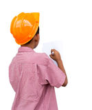 Engineers boy. The boy wears a hat  engineers are writing Stock Photo