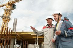 Engineers builders at construction stock image