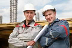 Engineers builders at construction royalty free stock photos