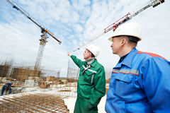 Engineers builders at construction site Royalty Free Stock Images