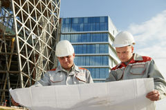 Engineers builders at construction site Royalty Free Stock Photos
