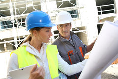Engineers on building site analysing plan Stock Photography